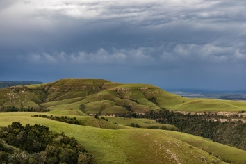 green hills grey skies