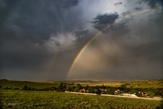 rainbow and storms