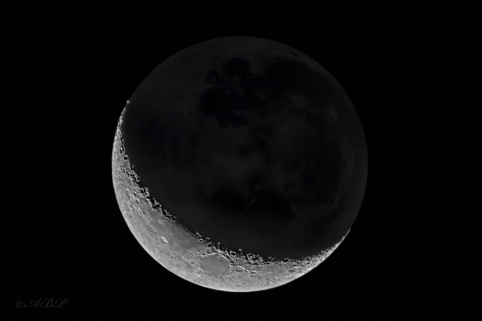 waxing crescent moon with earth shine visible